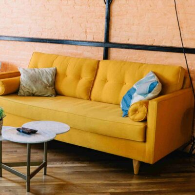 mustard sofa with rollar cushions